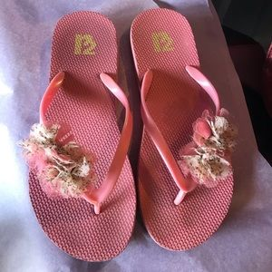 Coral flip flops by R2 with floral embellishments